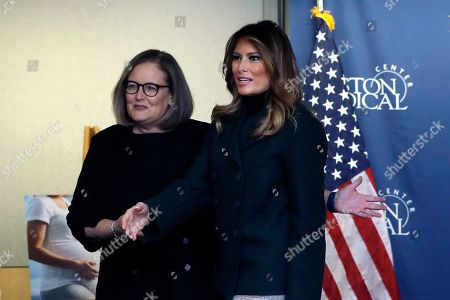 Kate Walsh, Melania Trump. President and CEO of Boston Medical Center Kate Walsh, left, introduces first lady Melania Trump, right, to medical staff at the before participating in a round table discussion during a visit to Boston Medical Center, in Boston