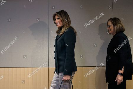 Melania Trump, Kate Walsh. First lady Melania Trump, left, and President and CEO of Boston Medical Center Kate Walsh, right, enter a conference room before participating in a round table discussion during a visit to the medical center, in Boston