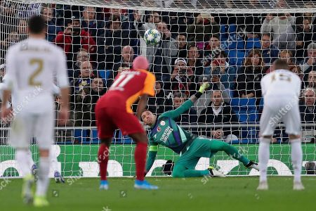 Galatasaray's goalkeeper Fernando Muslera fails to stop a penalty goal by Real Madrid's Sergio Ramos during a Champions League group A soccer match between Real Madrid and Galatasaray at the Santiago Bernabeu stadium in Madrid, Spain