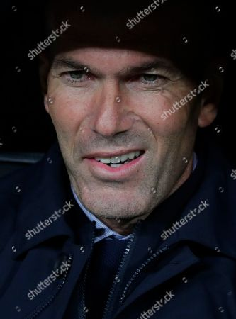 Real Madrid's head coach Zinedine Zidane waits for the start of a Champions League group A soccer match between Real Madrid and Galatasaray at the Santiago Bernabeu stadium in Madrid, Spain
