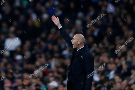 Real Madrid's head coach Zinedine Zidane shouts during a Champions League group A soccer match between Real Madrid and Galatasaray at the Santiago Bernabeu stadium in Madrid, Spain