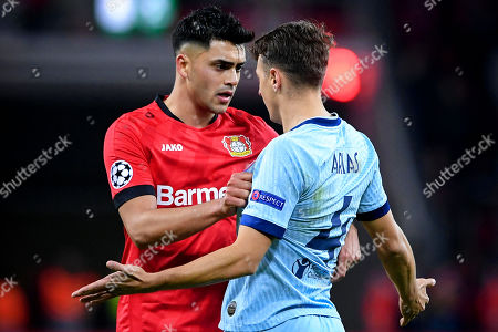 Leverkusen's Nadiem Amiri (L) argues with Atletico's Santiago Arias (R) during the UEFA Champions League group D soccer match between Bayer Leverkusen and Atletico Madrid in Leverkusen, Germany, 06 November 2019.