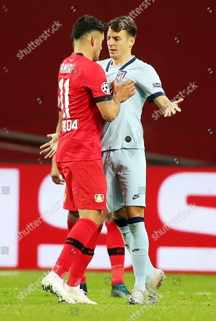 Nadiem Amiri (L) of Bayer Leverkusen and Santiago Arias of Atletico during the UEFA Champions League group D soccer match between Bayer Leverkusen and Atletico Madrid in Leverkusen, Germany, 06 November 2019.