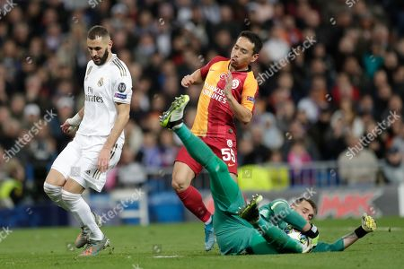Galatasaray's goalkeeper Fernando Muslera, makes a save during a Champions League group A soccer match between Real Madrid and Galatasaray at the Santiago Bernabeu stadium in Madrid