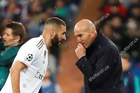 Real Madrid's head coach Zinedine Zidane (R) gives instructions to Karim Benzema (L) during the UEFA Champions League group A soccer match between Real Madrid and Galatasaray Istanbul at the Santiago Bernabeu Stadium in Madrid, Spain, 06 November 2019.