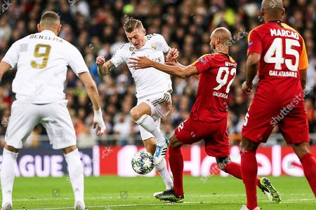 Real Madrid's Toni Kroos (2-L) in action against Galatasaray's Steven Nzonzi (2-R) during the UEFA Champions League group A soccer match between Real Madrid and Galatasaray Istanbul at the Santiago Bernabeu Stadium in Madrid, Spain, 06 November 2019.