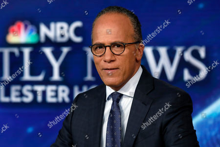 NBC Nightly News and Dateline anchor Lester Holt poses for photos on the Nightly News set, at NBC headquarters, in New York