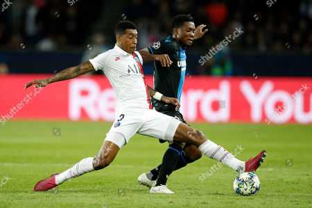 Paris Saint Germain's Presnel Kimpembe (L)  in action against Brugge?s Emmanuel Dennis (R)  during the UEFA Champions League Group A soccer match between Paris Saint Germain and Club Brugge at the Parc des Princes stadium in Paris, France, 06 November 2019.