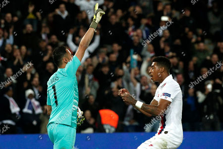 Stock Image of Paris Saint Germain goalkeeper Keylor Navas reacts with team mate Presnel Kimpembe (R)  after saving a penalty kick during the UEFA Champions League Group A soccer match between Paris Saint Germain and Club Brugge at the Parc des Princes stadium in Paris, France, 06 November 2019.