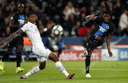 Paris Saint Germain's Presnel Kimpembe (L) and Brugge?s David Okereke in action during the UEFA Champions League Group A soccer match between Paris Saint Germain and Club Brugge at the Parc des Princes stadium in Paris, France, 06 November 2019.