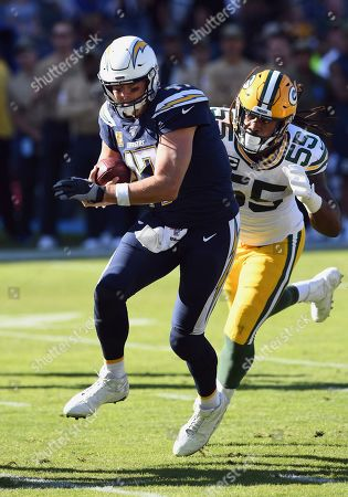 Philip Rivers - Za'Darius Smith. Los Angeles Chargers quarterback Philip Rivers (17) scrambles away from Green Bay Packers linebacker Za'Darius Smith (55) during an NFL football game, in Carson, Calif. The Chargers defeated the Packers 26-11