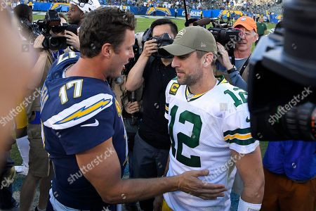 Los Angeles Chargers quarterback Philip Rivers, left, greets Green Bay Packers quarterback Aaron Rodgers after an NFL football game, in Carson, Calif
