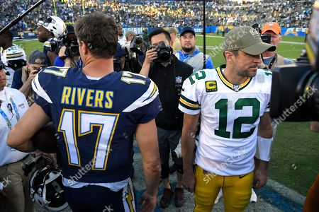 Los Angeles Chargers quarterback Philip Rivers, left, and Green Bay Packers quarterback Aaron Rodgers part after greeting each other following an NFL football game, in Carson, Calif