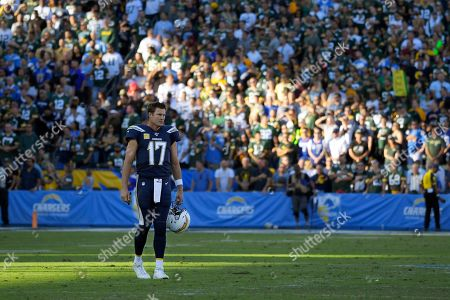 Los Angeles Chargers quarterback Philip Rivers stands on the field as God Bless America is sung during the second half of an NFL football game against the Green Bay Packers, in Carson, Calif
