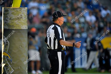 Back judge Greg Meyer stands on the field during the second half of an NFL football game between the Los Angeles Chargers and the Green Bay Packers, in Carson, Calif