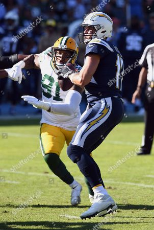Philip Rivers - Preston Smith. Los Angeles Chargers quarterback Philip Rivers (17) back to pass while Green Bay Packers linebacker Preston Smith (91) rushes Rivers during an NFL football game, in Carson, Calif. The Chargers defeated the Packers 26-11