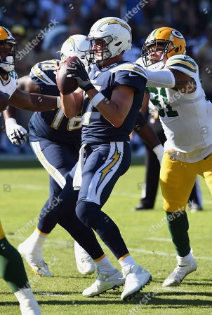 Philip Rivers - Preston Smith. Los Angeles Chargers quarterback Philip Rivers (17) is grabbed from behind by Green Bay Packers linebacker Preston Smith (91) during an NFL football game, in Carson, Calif. The Chargers defeated the Packers 26-11