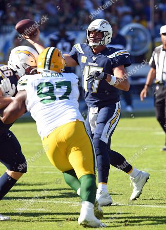 Los Angeles Chargers quarterback Philip Rivers (17) throws a pass during an NFL football game against the Green Bay Packers, in Carson, Calif. The Chargers defeated the Packers 26-11