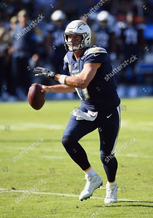 Los Angeles Chargers quarterback Philip Rivers (17) scrambles with the ball during an NFL football game against the Green Bay Packers, in Carson, Calif. The Chargers defeated the Packers 26-11
