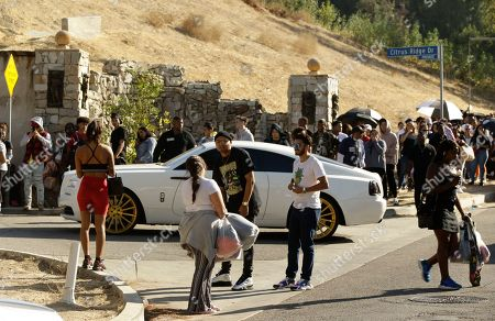 People carry singer Chris Brown's merchandise as they leave his home in the Tarzana area of Los Angeles . Chris Brown held a high-end yard sale Wednesday at his Los Angeles home, with hundreds of fans, gawkers and bargain-seekers waiting for hours to try to get a piece of the singer's stuff. Brown posted a flyer on his Instagram and Twitter accounts Tuesday night that included the address of his suburban mansion in the Tarzana neighborhood of the San Fernando Valley
