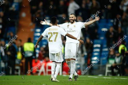 Rodrygo celebrates a goal with Karim Benzema of Real Madrid