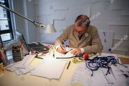 At Atelier Caito for Herve Pierre in New York, designer Herve Pierre sketches one of the dresses actress Jessica Hecht will be fitted for to wear to the Emmys