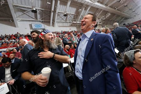 Stock Picture of Willie Robertson, left, of the reality TV series Duck Dynasty, laughs with Louisiana Attorney Gen. Jeff Landry before the start of a rally for President Donald Trump in Monroe, La., . Trump was in Louisiana to promote Republican Gubernatorial candidate Eddie Rispone, who is in a runoff with incumbent Democrat Gov. John Bel Edwards