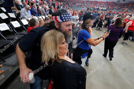 Willie Robertson, of the reality TV series Duck Dynasty, poses with rally-goers before the start of a rally for President Donald Trump in Monroe, La