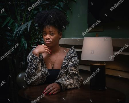 Ari Lennox poses for a portrait at her Manhattan Hotel, in New York City
