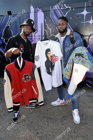 "Darius Logan, Dominique Logan. Darius Logan, left, and Dominique Logan of the musical duo ""Blaq Tuxedo"" shop at Chris Brown's yard sale at Brown's home in the Tarzana neighborhood of the San Fernando Valley, in Los Angeles"