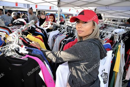 Amber Delossantos, of Vallejo, Calif., shops at Chris Brown's yard sale at Brown's home in the Tarzana neighborhood of the San Fernando Valley, in Los Angeles
