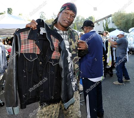 EDDIEB, of North Hollywood, Calif., shops at Chris Brown's yard sale at Brown's home in the Tarzana neighborhood of the San Fernando Valley, in Los Angeles