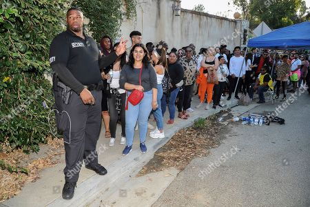 Chris Brown fans wait in line to attend Brown's yard sale at his home in the Tarzana neighborhood of the San Fernando Valley, in Los Angeles