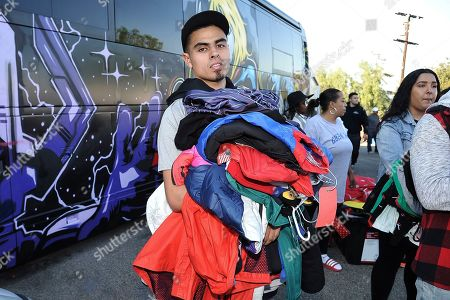 Justin Quintna, of Los Angeles, shops at Chris Brown's yard sale at Brown's home in the Tarzana neighborhood of the San Fernando Valley, in Los Angeles