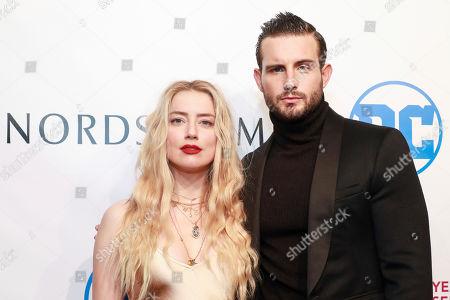 Amber Heard, Nico Tortorella. Amber Heard and Nico Tortorella attend the 2019 Emery Awards at Cipriani Wall Street, in New York