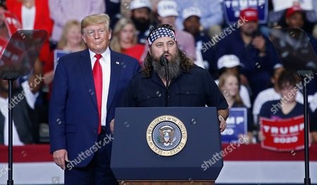 Stock Photo of Willie Robertson (R), a American TV personality and known for his role in television show Duck Dynasty, speaks to the crowd while on stage with US President Donald J. Trump (L) at a Keep America Great Rally inside the Monroe Civic Center in Monroe, Louisiana, USA, 06 November 2019.