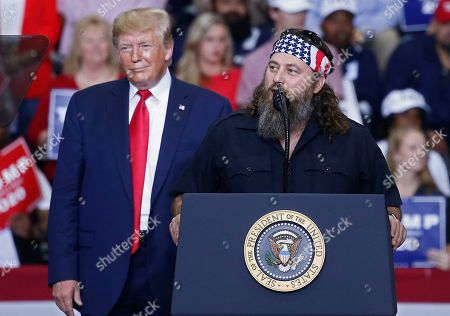 Stock Image of Willie Robertson (R), a American TV personality and known for his role in television show Duck Dynasty, speaks to the crowd while on stage with US President Donald J. Trump (L) at a Keep America Great Rally inside the Monroe Civic Center in Monroe, Louisiana, USA, 06 November 2019.