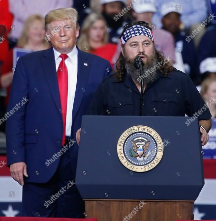 Willie Robertson (R), a American TV personality and known for his role in television show Duck Dynasty, speaks to the crowd while on stage with US President Donald J. Trump (L) at a Keep America Great Rally inside the Monroe Civic Center in Monroe, Louisiana, USA, 06 November 2019.