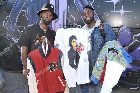 "Darius Logan, Dominique Logan. Darius Logan, left, and Dominique Logan of the musical duo ""Blaq Tuxedo"" shopping Chris Brown's yard sale at Brown's home in the Tarzana neighborhood of the San Fernando Valley, in Los Angeles"