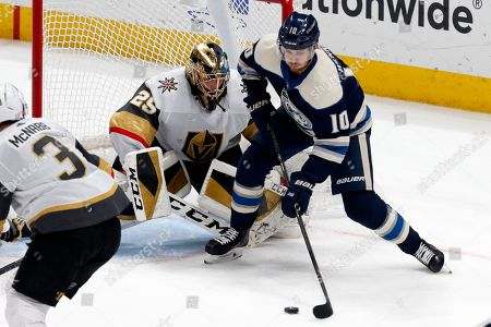 Stock Photo of Columbus Blue Jackets forward Alexander Wennberg, right, of Sweden, controls the puck in front of Vegas Golden Knights goalie Marc-Andre Fleury, center, and Golden Knights defenseman Brayden McNabb during an NHL hockey game in Columbus, Ohio, . The Golden Knights won 2-1
