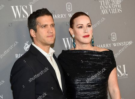 Stock Photo of Panio Gianopoulos, Molly Ringwald. Actress Molly Ringwald, right, and husband Panio Gianopoulo attend the WSJ. Magazine 2019 Innovator Awards at the Museum of Modern Art, in New York