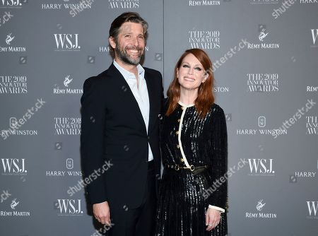 Bart Freundlich, Julianne Moore. Honoree actor Julianne Moore, right, and husband Bart Freundlich attend the WSJ. Magazine 2019 Innovator Awards at the Museum of Modern Art, in New York