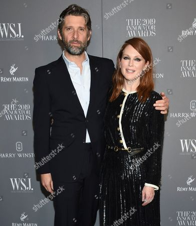 Stock Image of Bart Freundlich, Julianne Moore. Honoree actor Julianne Moore, right, and husband Bart Freundlich attend the WSJ. Magazine 2019 Innovator Awards at the Museum of Modern Art, in New York