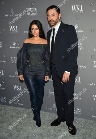 Kim Kardashian West, Riccardo Tisci. Kim Kardashian West poses with honoree Riccardo Tisci at the WSJ. Magazine 2019 Innovator Awards at the Museum of Modern Art, in New York