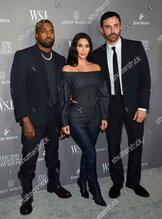 Kanye West, Kim Kardashian West, Riccardo Tisci. Kanye West, left, and wife Kim Kardashian West pose with honoree Riccardo Tisci at the WSJ. Magazine 2019 Innovator Awards at the Museum of Modern Art, in New York