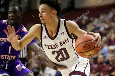 Stock Picture of Texas A&M guard Andre Gordon (20) drives the baseline against Northwestern State guard LaTerrance Reed (1) during the second half of an NCAA college basketball game, in College Station, Texas