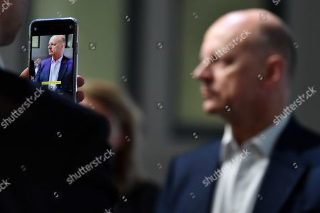 A man takes a photo of Siemens Chief Financial Officer (CFO) Ralf Peter Thomas (R) as he speaks to journalists prior to the Siemens annual press conference in Munich, Germany, 07 November 2019.