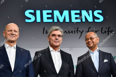 Siemens Chief Financial Officer (CFO) Ralf Peter Thomas (L), Siemens CEO Joe Kaeser (C) and Co-CEO Gas and Power Siemens Gamesa Renewable Energy, Michael Sen (R), pose for a photo as they arrive at the Siemens annual press conference in Munich, Germany, 07 November 2019.