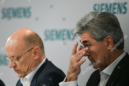 Siemens CEO Joe Kaeser (R) reacts next to Siemens Chief Financial Officer (CFO) Ralf Peter Thomas (L) during the Siemens annual press conference in Munich, Germany, 07 November 2019.
