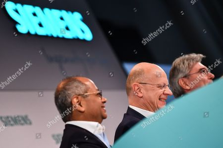 Siemens Chief Financial Officer (CFO) Ralf Peter Thomas (L), Siemens CEO Joe Kaeser (C) and Co-CEO Gas and Power Siemens Gamesa Renewable Energy, Michael Sen (R), react during the Siemens annual press conference in Munich, Germany, 07 November 2019.